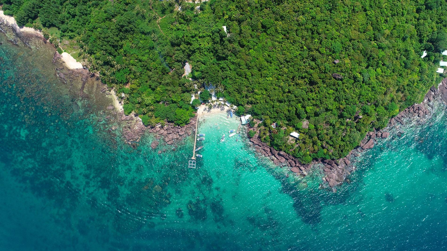 Une vue du ciel sur une île paradisiaque eau turquoise Page d