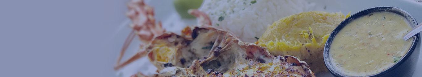 En tête zoom plat cuisine gastronomie recette de langouste grillé sauce chien martinique guadeloupe